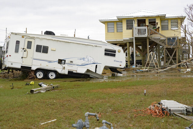 "A camping trailer by a neighboring camp has been damaged by Hurricane Zeta in Grand Isle, La., Friday, Oct. 30, 2020.  Gov. John Bel Edwards says the damage from Zeta was ""catastrophic"" in Grand Isle, a barrier island community south of New Orleans that was one of the hardest-hit areas. (AP Photo/Matthew Hinton)"