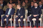 Lebanese President Michel Aoun, center, former Prime Minister Saad Hariri, right, and Lebanese Parliament Speaker Nabih Berri, left, attend a military parade to mark the 76th anniversary of Lebanon's independence from France at the Lebanese Defense Ministry, in Yarzeh near Beirut, Lebanon, Friday, Nov. 22, 2019. Lebanon's top politicians Friday attended a military parade on the country's 76th Independence Day, appearing for the first time since the government resigned amid nationwide protests now in their second month. (AP Photo/Hassan Ammar)
