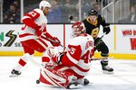 Detroit Red Wings' Jonathan Bernier (45) blocks a shot by Boston Bruins' Karson Kuhlman (83) during the second period of an NHL hockey game in Boston, Saturday, Feb. 15, 2020. (AP Photo/Michael Dwyer)