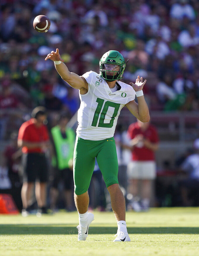 Oregon quarterback Justin Herbert (10) throws against Stanford during the first half of an NCAA college football game on Saturday, Sept. 21, 2019, in Stanford, Calif. (AP Photo/Tony Avelar)