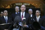 United States Attorney Andrew Lelling, center, speaks outside federal court after the sentencing hearing for Insys Therapeutics founder John Kapoor, Thursday, Jan. 23, 2020, in Boston. Kapoor was sentenced to spend 5 1/2 years in prison for orchestrating a bribery and kickback scheme prosecutors said helped fuel the opioid crisis. He was found guilty the previous May of racketeering and conspiracy in a scheme where millions of dollars in bribes were paid to doctors across the United States to prescribe the company's highly addictive oral fentanyl spray, known as Subsys. (AP Photo/Charles Krupa)