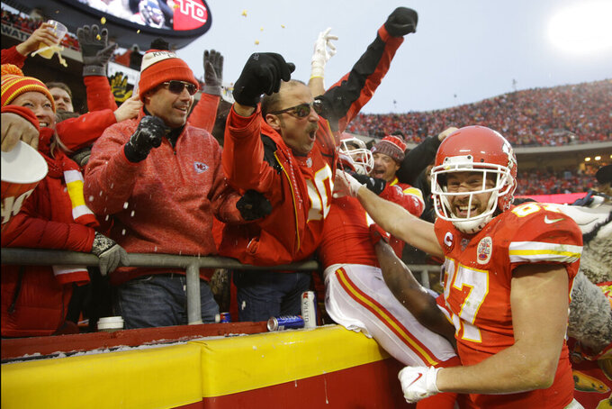 Kansas City Chiefs tight end Travis Kelce (87) celebrates with fans after tight end Blake Bell scored a touchdown against the Houston Texans, during the second half of an NFL divisional playoff football game, in Kansas City, Mo., Sunday, Jan. 12, 2020. (AP Photo/Charlie Riedel)