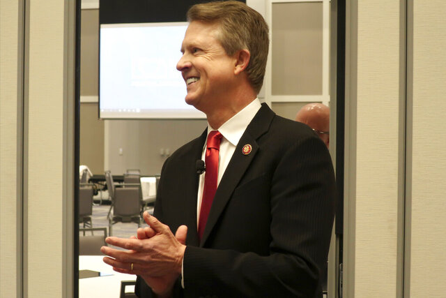 FILE - In this Feb. 1, 2020 file photo, U.S. Rep. Roger Marshall, R-Kan., a candidate for the U.S. Senate, awaits the start of a debate in Olathe, Marshall's critics on the political right are working to hobble the western Kansas congressman's bid for the U.S. Senate in the final three months of a primary campaign as he fights to overcome conservative immigration hardliner Kris Kobach in a crowded field. (AP Photo/John Hanna File)