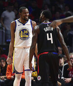 Golden State Warriors forward Kevin Durant, left, and Los Angeles Clippers forward JaMychal Green jaw at each other during the second half in Game 3 of a first-round NBA basketball playoff series Thursday, April 18, 2019, in Los Angeles. The Warriors won 132-105. (AP Photo/Mark J. Terrill)