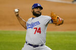 Los Angeles Dodgers relief pitcher Kenley Jansen throws against the Atlanta Braves during the sixth inning in Game 3 of a baseball National League Championship Series Wednesday, Oct. 14, 2020, in Arlington, Texas. (AP Photo/Tony Gutierrez)