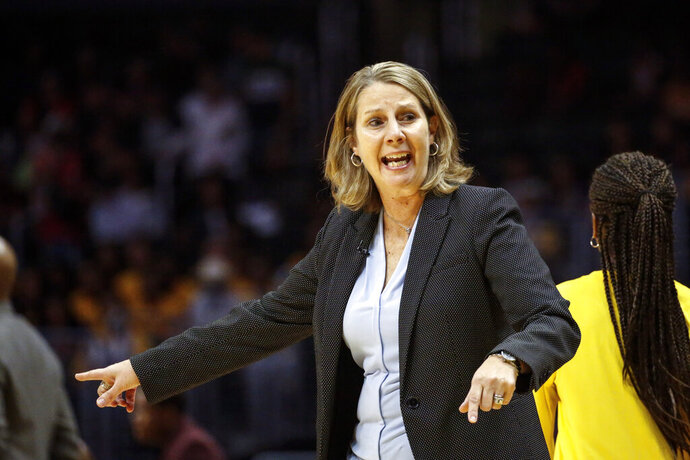 FILE - In this Sunday, Sept. 8, 2019 file photo, Minnesota Lynx's head coach Cheryl Reeve instructs her players during a WNBA basketball game against the Los Angeles Sparks in Los Angeles. Minnesota Lynx general manager and coach Cheryl Reeve has been chosen WNBA basketball executive of the year after steering the team to a ninth straight appearance in the playoffs despite losing several longtime stars, Wednesday, Sept. 18, 2019. (AP Photo/Ringo H.W. Chiu, File)