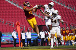CORRECTS TO SECOND HALF, NOT FIRST HALF - Southern California wide receiver Drake London (15) catches a pass in the end zone for a touchdown as Arizona State defensive back Kejuan Markham (12) and linebacker Kyle Soelle (34) defend during the second half of an NCAA  college football game Saturday, Nov. 7, 2020, in Los Angeles. USC won 28-27. (AP Photo/Ashley Landis)