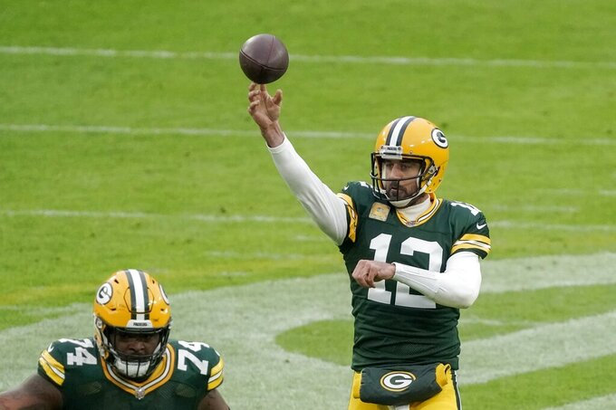 Green Bay Packers' Aaron Rodgers throws during the first half of an NFL football game against the Jacksonville Jaguars Sunday, Nov. 15, 2020, in Green Bay, Wis. (AP Photo/Morry Gash)