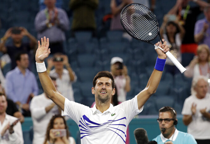 Novak Djokovic, of Serbia, celebrates after his match against Federico Delbonis, of Argentina, during the Miami Open tennis tournament, Sunday, March 24, 2019, in Miami Gardens, Fla. Djokovic won 7-5, 4-6, 6-1. (AP Photo/Lynne Sladky)