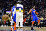 Oklahoma City Thunder center Steven Adams (12) celebrates a basket from half-court against the New Orleans Pelicans during the first half of an NBA basketball game in New Orleans, Thursday, Feb. 13, 2020. (AP Photo/Matthew Hinton)