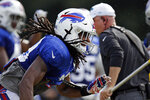 Buffalo Bills' Tremaine Edmunds runs a play during an NFL football training camp with the Carolina Panthers in Spartanburg, S.C., Wednesday, Aug. 14, 2019. (AP Photo/Gerry Broome)