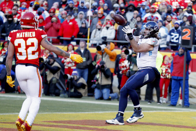 Tennessee Titans' Dennis Kelly, right, catches a touchdown pass during the first half of the NFL AFC Championship football game against the Kansas City Chiefs Sunday, Jan. 19, 2020, in Kansas City, MO. (AP Photo/Charlie Neibergall)