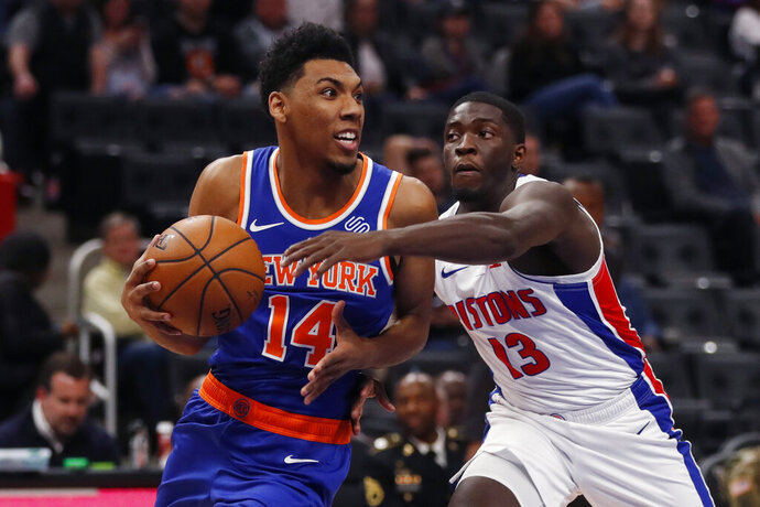 New York Knicks guard Allonzo Trier (14) looks to pass as Detroit Pistons guard Khyri Thomas (13) defends during the second half of an NBA basketball game, Wednesday, Nov. 6, 2019, in Detroit. (AP Photo/Carlos Osorio)