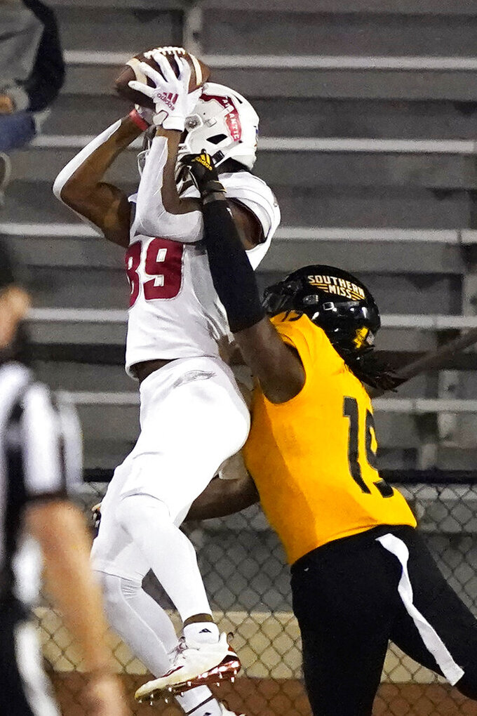 Florida Atlantic wide receiver Brandon Robinson (89) pulls in a touchdown pass over Southern Mississippi defensive back Ky'el Hemby (19) during the first half of an NCAA college football game Thursday, Dec. 10, 2020, in Hattiesburg, Miss. (AP Photo/Rogelio V. Solis)
