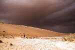 In this undated photo provided by the Palaeodeserts Project in September 2021, a storm arrives during an archaeological excavation of the remains of an ancient lake in northern Saudi Arabia, where ancient humans lived alongside animals such as hippos.(Klint Janulis/Palaeodeserts Project via AP)