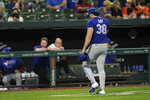 Toronto Blue Jays starting pitcher Robbie Ray heads to the dugout after being pulled from the game during the fifth inning of a baseball game, Friday, Sept. 10, 2021, in Baltimore. (AP Photo/Julio Cortez)