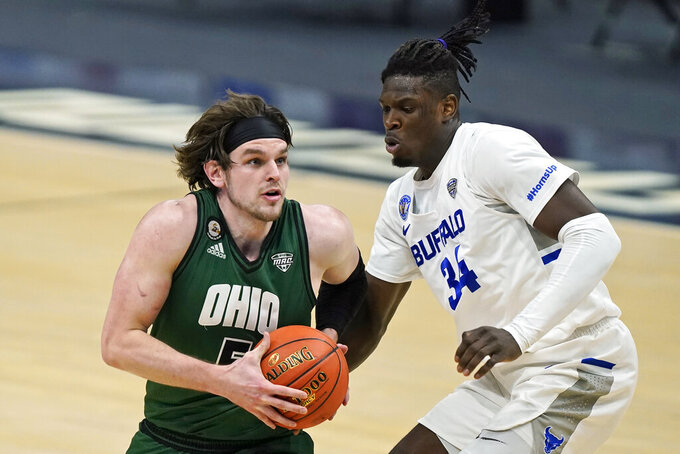 Ohio's Ben Vander Plas (5) drives to the basket against Buffalo's Josh Mballa (34) during the first half of an NCAA college basketball game for the championship of the Mid-American Conference men's tournament Saturday, March 13, 2021, in Cleveland. (AP Photo/Tony Dejak)