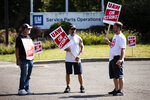Workers picket outside a General Motors facility in Langhorne, Pa., Monday, Sept. 23, 2019. The strike against General Motors by 49,000 United Auto Workers entered its second week Monday with progress reported in negotiations but no clear end in sight. (AP Photo/Matt Rourke)