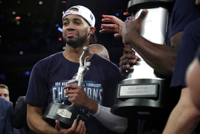 Villanova guard Phil Booth hols the MVP trophy after his team defeated Seton Hall 74-72 in an NCAA college basketball game in the championship of the Big East Conference tournament, Saturday, March 16, 2019, in New York.  (AP Photo/Julio Cortez)
