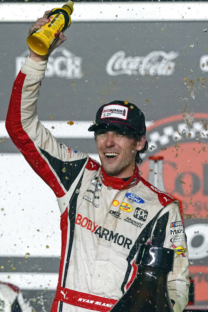 Ryan Blaney celebrates in Victory Lane after winning a NASCAR Cup Series auto race at Daytona International Speedway, Saturday, Aug. 28, 2021, in Daytona Beach, Fla. (AP Photo/John Raoux)