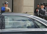Japanese Crown Princess Kiko looks out the window of a car as she and Crown Prince Akishino arrive for a welcoming ceremony at the Polish Presidential Palace in Warsaw, Poland, on Friday June 28, 2019. The visit marks the centenary of diplomatic relations between Poland and Japan.(AP Photo/Czarek Sokolowski)