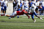 Ohio State linebacker Cody Simon, left, tries to tackle Tulsa receiver Josh Johnson during the first half of an NCAA college football game Saturday, Sept. 18, 2021, in Columbus, Ohio. (AP Photo/Jay LaPrete)