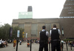 Emergency crews attending a scene at the Tate Modern art gallery, London, Sunday, Aug. 4, 2019. London police say a teenager was arrested after a child