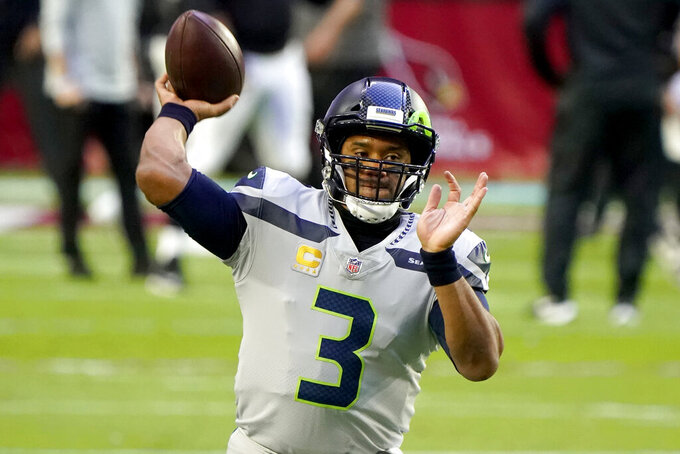 Seattle Seahawks quarterback Russell Wilson (3) warms up prior to an NFL football game against the Arizona Cardinals, Sunday, Oct. 25, 2020, in Glendale, Ariz. (AP Photo/Rick Scuteri)