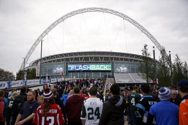 FILE - In this Oct. 26, 2014, file photo, sans arrive at Wembley Stadium before an NFL football game between the Atlanta Falcons and the Detroit Lions in London. The NFL is moving its five games scheduled for London and Mexico City this season back to U.S. stadiums because of the coronavirus pandemic. All five regular-season games will now be played at the stadiums of the host teams.  (AP Photo/Matt Dunham, File)