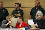 Parkland school shooter Nikolas Cruz, center, speaks with defense attorney Melisa McNeill, with defense attorney Diane Cuddihy at right, before a hearing at the Broward Courthouse in Fort Lauderdale, Fla., Tuesday, Jan. 15, 2019. Cruz returned court this week for hearings on the Valentine's Day 2018 shooting at Marjory Stoneman Douglas High School in Parkland, Fla., and on accusations he assaulted a corrections officer. (Amy Beth Bennett/South Florida Sun-Sentinel via AP, Pool)