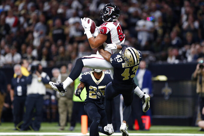 Atlanta Falcons tight end Austin Hooper (81) pulls in a touchdown pass over New Orleans Saints free safety Marcus Williams (43) and cornerback Eli Apple (25) in the first half of an NFL football game in New Orleans, Sunday, Nov. 10, 2019. (AP Photo/Rusty Costanza)