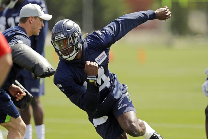"In this Friday, May 3, 2019 photo, Seattle Seahawks rookie wide receiver DK Metcalf runs a drill during NFL football rookie mini camp in Renton, Wash. It took one rookie minicamp practice for Metcalf to catch the attention of Seahawks coach Pete Carroll. ""Maybe he's even more unique than we thought coming in,"" Carroll says. (AP Photo/Ted S. Warren)"