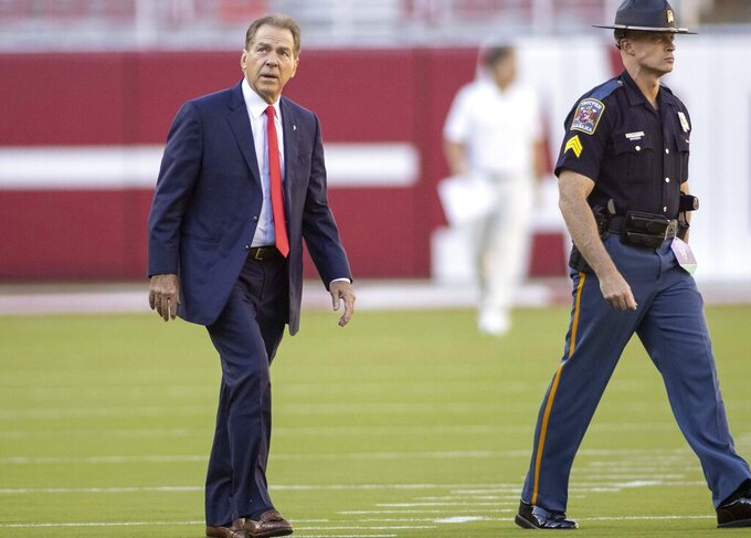 Alabama head coach Nick Saban, left, tours the field before an NCAA college football game against Tennessee, Saturday, Oct. 23, 2021, in Tuscaloosa, Ala. (AP Photo/Vasha Hunt)