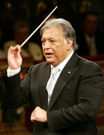 """FILE- In this Jan. 1, 2007 file photo, Maestro Zubin Mehta conducts the Vienna Philharmonic Orchestra during the traditional New Year's concert at Vienna's Musikverein. When Mehta joined the Israel Philharmonic Orchestra in 1969, Lahav Shani wasn't even alive. Now, at the age of 30, the Israeli wunderkind is poised to succeed his mentor at the helm of the acclaimed symphony. Mehta, 83, is set to step down late this year after leading the orchestra for half a century and serving as its """"music director for life"""" since 1981. (AP Photo/Hans Punz, File)"""