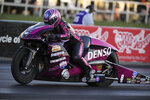 CORRECTS TO BROWNSBURG NOT INDIANAPOLIS - In this photo provided by the NHRA, Angie Smith powers to the provisional No. 1 spot on her Pro Stock Motorcycle to kick off the NHRA U.S. Nationals in Brownsburg, Ind., Friday, Sept. 4, 2020. ( Jerry Foss/NHRA via AP)