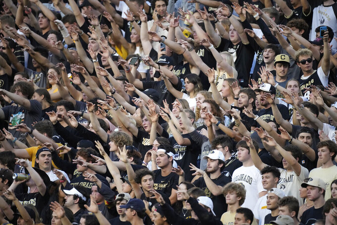 Fans cheer as the football is kicked by Colorado to Northern Colorado to open an NCAA college football game Friday, Sept. 3, 2021, in Boulder, Colo. (AP Photo/David Zalubowski)