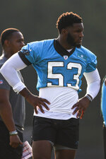 Carolina Panthers defensive end Brian Burns stands on a practice field at the NFL football team's training camp in Spartanburg, S.C., Thursday, July 29, 2021. (AP Photo/Nell Redmond)