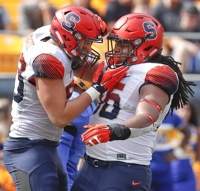 Pitt survives delay, rallies past Syracuse 44-37 in overtime