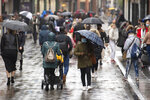 Many people wearing face masks as they move along a main shopping street in Nottingham, England, Tuesday Oct. 27, 2020.  The Nottingham area will move into the Tier 3 highest level of coronavirus restrictions on upcoming Thursday because of a surge in COVID-19.  (Joe Giddens/PA via AP)