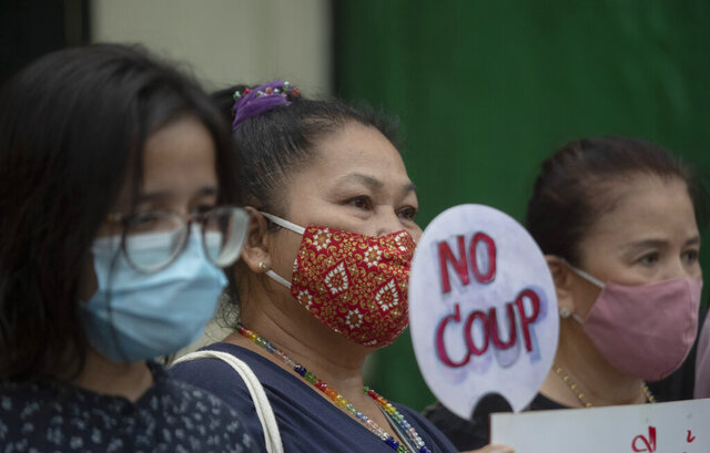 Thai anti-government protesters gather in front of the Royal Thai Army Headquarters in Bangkok, Thailand, Monday, July 20, 2020. Anti-government protesters are calling for a new constitution, new elections and an end to repressive laws. (AP Photo/Sakchai Lalit)