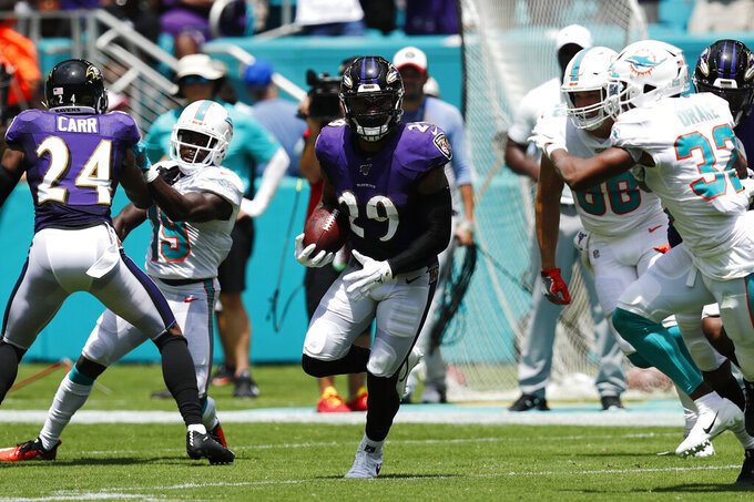 Baltimore Ravens free safety Earl Thomas (29) runs after intercepting a pass by Miami Dolphins quarterback Ryan Fitzpatrick , during the first half at an NFL football game, Sunday, Sept. 8, 2019, in Miami Gardens, Fla. (AP Photo/Brynn Anderson)