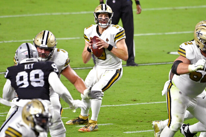 New Orleans Saints quarterback Drew Brees (9) drops back to pass against the Las Vegas Raiders during the first half of an NFL football game, Monday, Sept. 21, 2020, in Las Vegas. (AP Photo/David Becker)