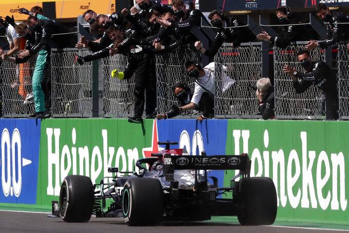 Mercedes driver Lewis Hamilton of Britain crosses the finish line to win the Portugal Formula One Grand Prix at the Algarve International Circuit near Portimao, Portugal, Sunday, May 2, 2021. (AP Photo/Manu Fernandez)