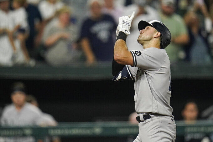 New York Yankees' Joey Gallo gestures after hitting a solo home run against the Baltimore Orioles during the eighth inning of a baseball game, Tuesday, Sept. 14, 2021, in Baltimore. (AP Photo/Julio Cortez)