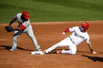 Washington Nationals' Trea Turner, right, slides into second ahead of the tag by Philadelphia Phillies second baseman Jean Segura, left, for a double during the third inning of the first game of a baseball doubleheader Tuesday, Sept. 22, 2020, in Washington. (AP Photo/Nick Wass)