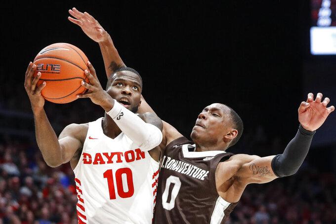 Dayton's Jalen Crutcher (10) shoots against St. Bonaventure's Kyle Lofton (0) during the first half of an NCAA college basketball game, Wednesday, Jan. 22, 2020, in Dayton, Ohio. (AP Photo/John Minchillo)
