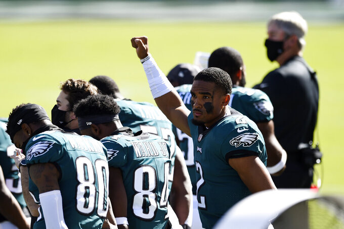 Philadelphia Eagles' Jalen Hurts gestures before before an NFL football game against the Baltimore Ravens, Sunday, Oct. 18, 2020, in Philadelphia. (AP Photo/Derik Hamilton)