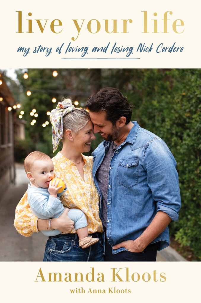 """This cover image released by Harper shows """"Live Your Life: My Story of Loving and Losing Nick Cordero"""" by Amanda Kloots with Anna Kloots. (Harper via AP)"""