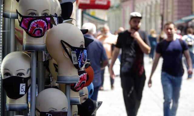 Masks placed on mannequins heads are displayed outside a shop in Sarajevo's main street, Bosnia, Monday, July 27, 2020. Regional WHO office in Bosnia expressed its concern with recent reports that medical institutions around the country are closing to maximum capacity as recent spike in COVID-19 infections are reaching record levels. (AP Photo/Eldar Emric)