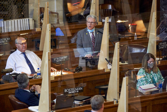 Speaker of the legislature Sen. Jim Scheer of Norfolk, top center, addresses lawmakers in Lincoln, Neb., Monday, July 20, 2020. Nebraska lawmakers resumed their session after a four-month pause triggered by the coronavirus pandemic. They still have major issues to address, including a property tax package and an upgrade of Nebraska's biggest tax incentive program, but all of that may be overshadowed by the pandemic's impact on tax revenue. (AP Photo/Nati Harnik)